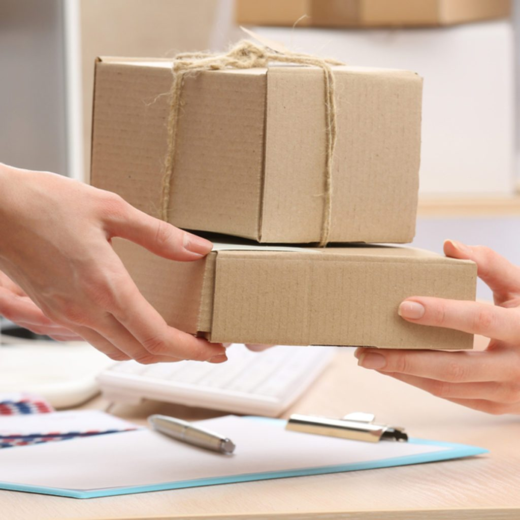 Woman gives parcel in post office; Shutterstock ID 282916904; Job (TFH, TOH, RD, BNB, CWM, CM): TOH