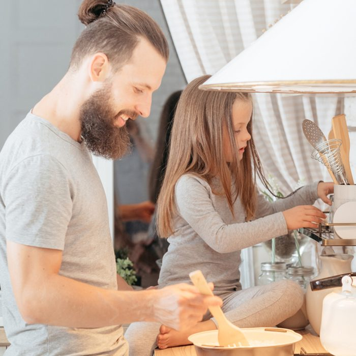 dad and daughter cooking in kitchen.