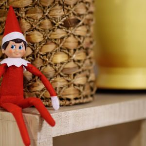 Funny Christmas toy elf on shelf. American christmas traditions. Xmas activities for family with kids
