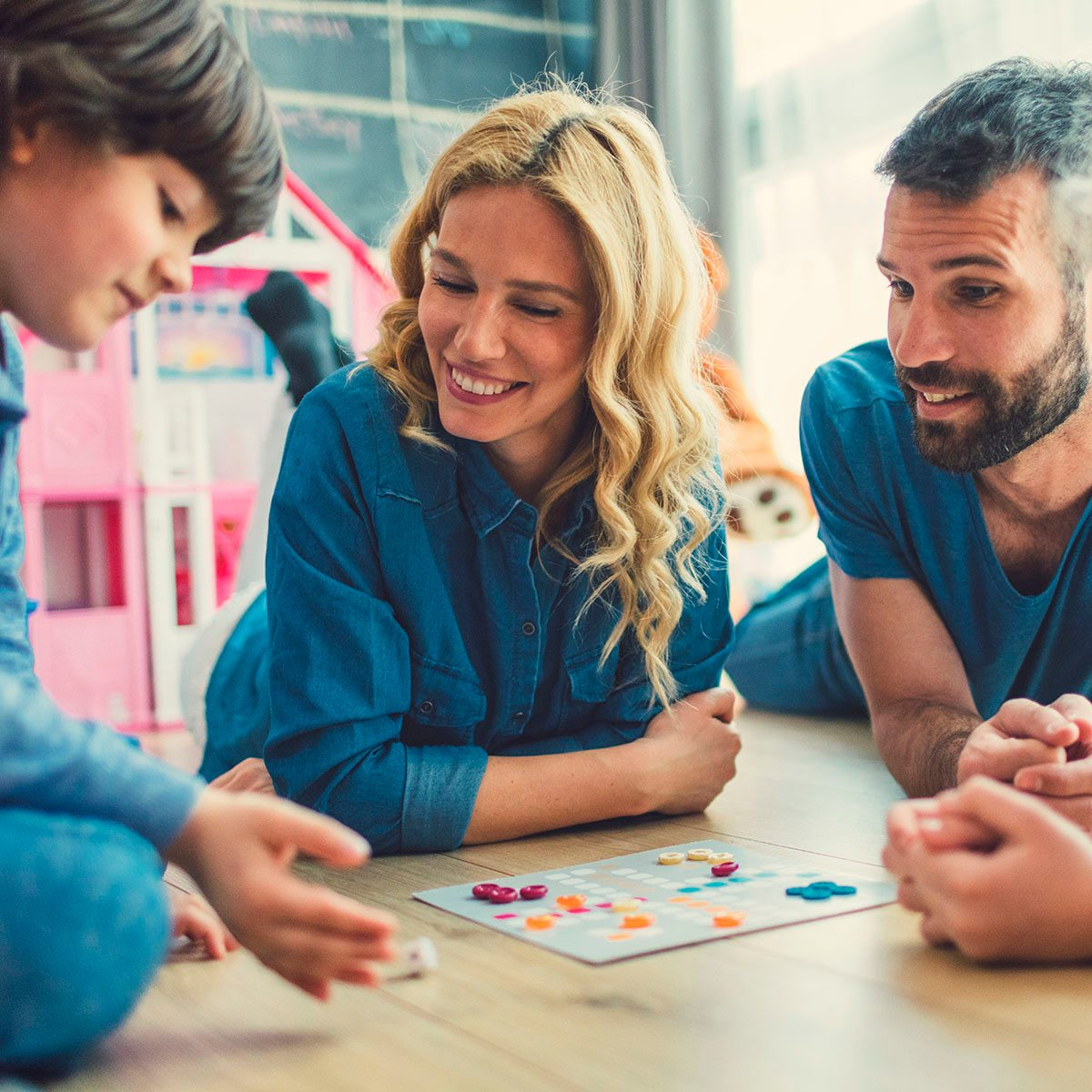 Family Playing Board Game At Home - new years activities for kids