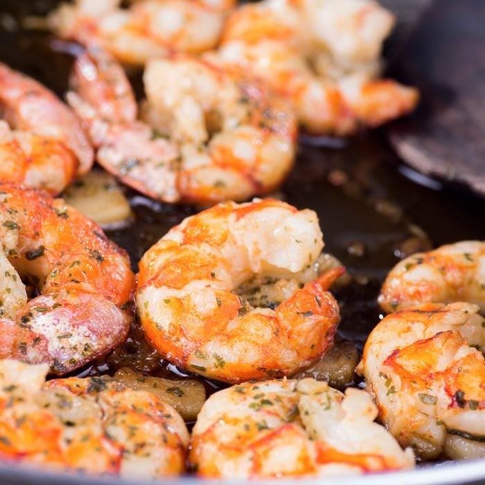 macro photograph of a shrimp and garlic stew
