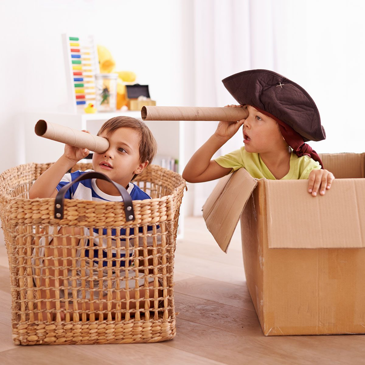 Shot of two little boys pretending to be pirates in their bedroom
