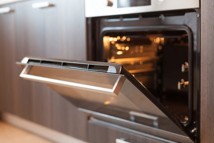 Empty open electric oven with hot air ventilation.