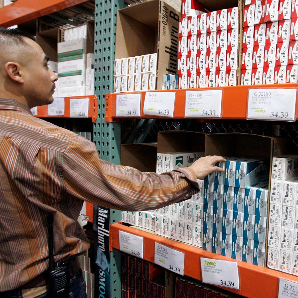 Shopper reaching for items on shelf