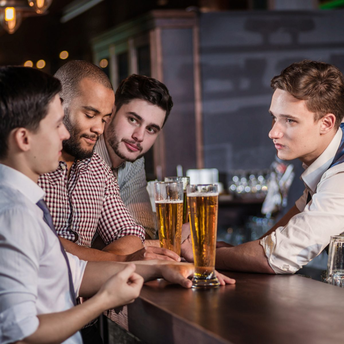The bartender takes orders for beer. Three cheerful friend makes ordering a beer from the bartender at the bar; Shutterstock ID 229951054; Job (TFH, TOH, RD, BNB, CWM, CM): TOH