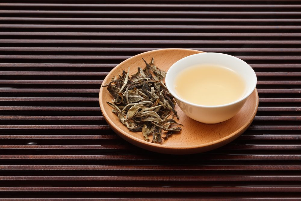 white tea with leaves