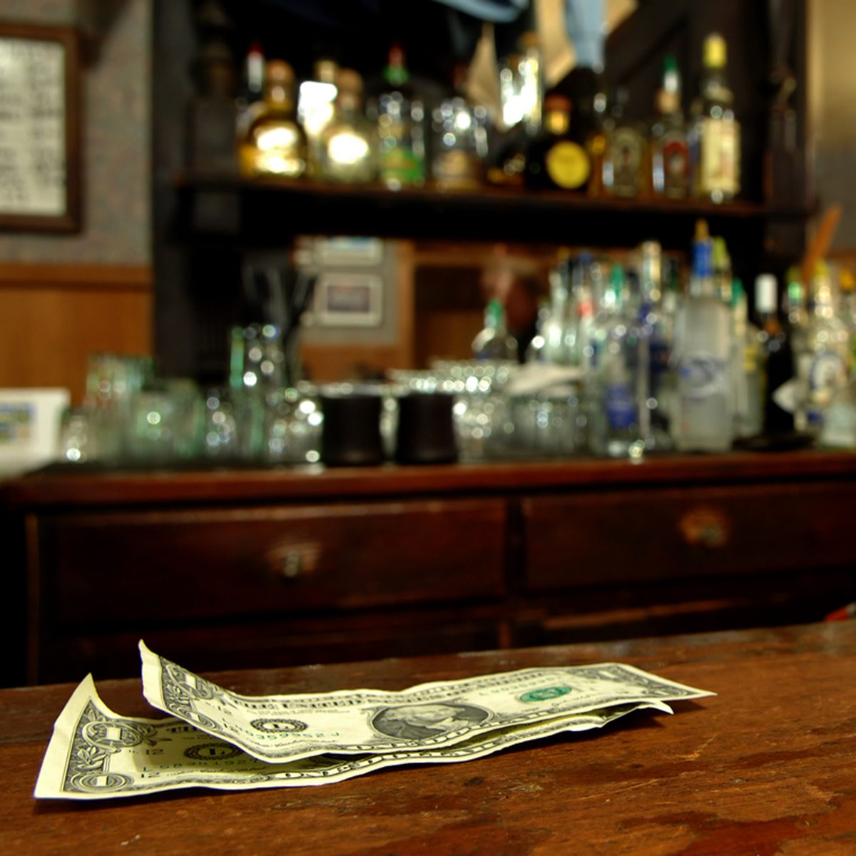 A Couple of Dollars Awaits The Bartender in a Rustic Bar; Shutterstock ID 3131544; Job (TFH, TOH, RD, BNB, CWM, CM): TOH