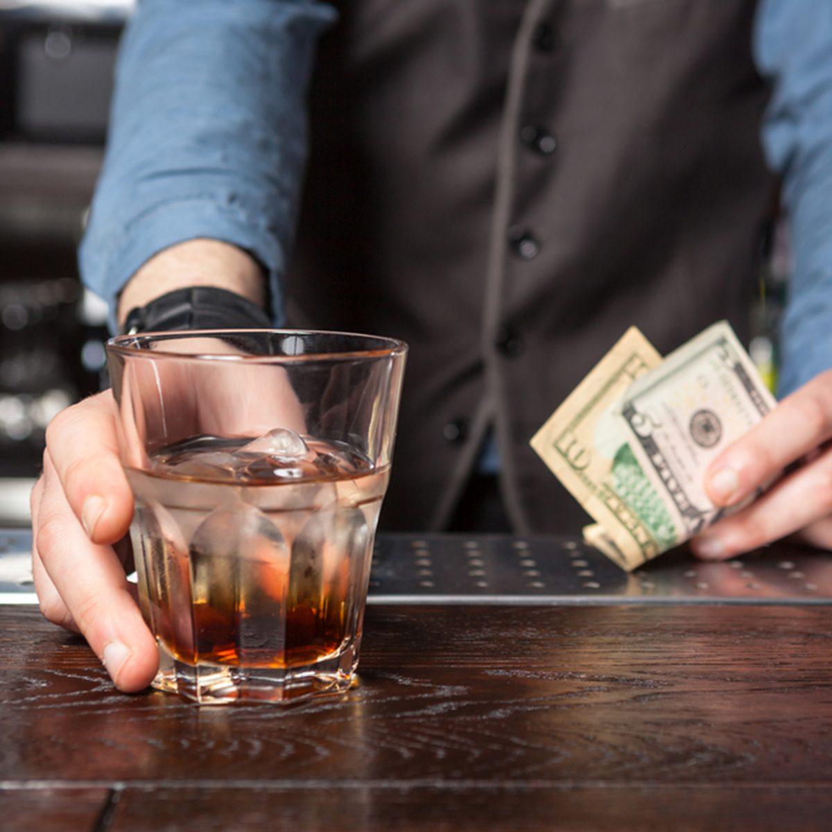 Barman giving whiskey glass with booze - closeup.; Shutterstock ID 409465387; Job (TFH, TOH, RD, BNB, CWM, CM): TOH