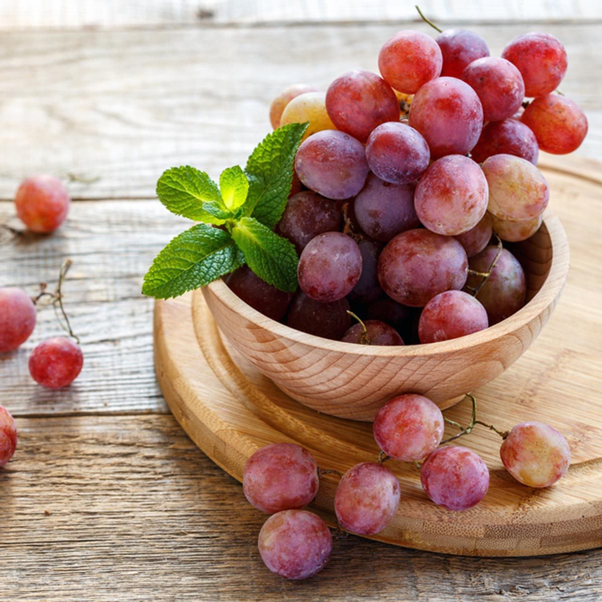 Bowl with pink grapes on a wooden stand.; Shutterstock ID 523852714; Job (TFH, TOH, RD, BNB, CWM, CM): TOH