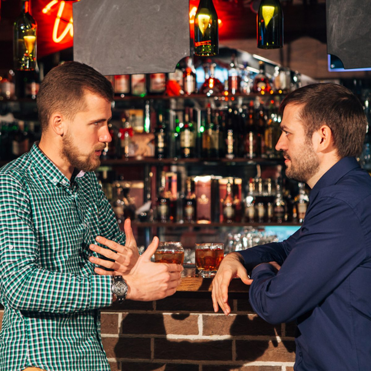 two young man talking at counter. friends standing in bar and drinking whisky; Shutterstock ID 542334136; Job (TFH, TOH, RD, BNB, CWM, CM): TOH
