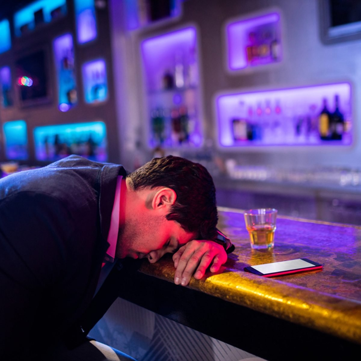 Depressed drunk man sleeping with his head on the table in bar; Shutterstock ID 547877209; Job (TFH, TOH, RD, BNB, CWM, CM): TOH