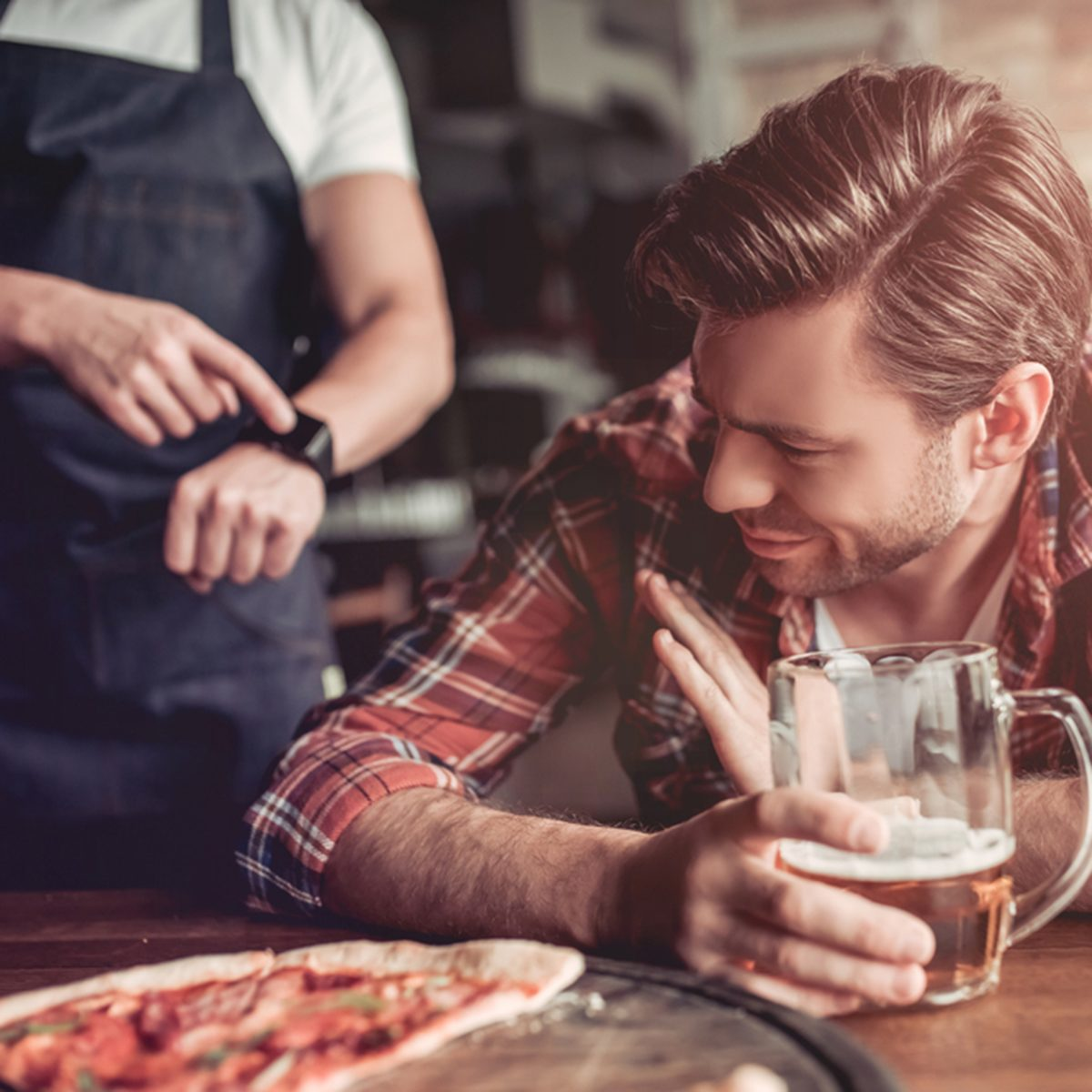 We are closed! Waiter is trying to get awake drunk visitor in bar.; Shutterstock ID 658915978; Job (TFH, TOH, RD, BNB, CWM, CM): TOH