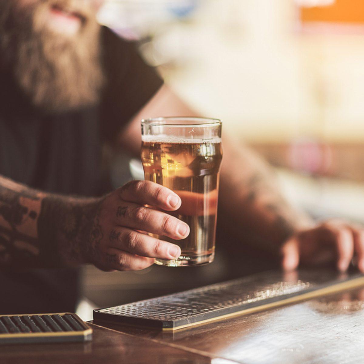 Tattooed bartender with beard working in pub; Shutterstock ID 662292103; Job (TFH, TOH, RD, BNB, CWM, CM): TOH