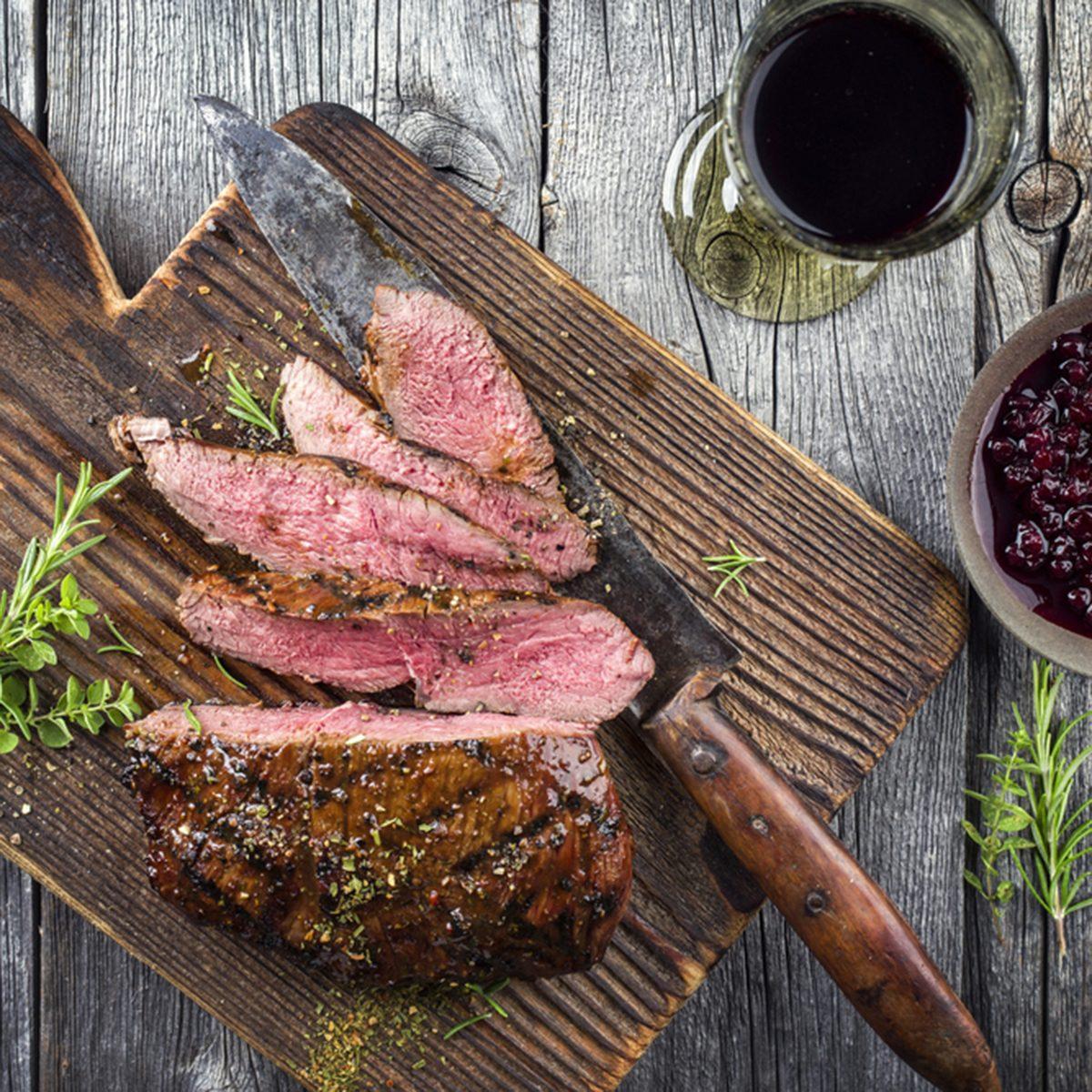 Venison Steak on old Cutting Board