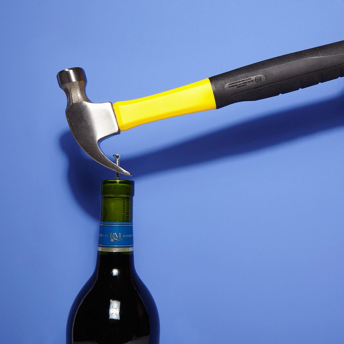 Using a hammer on a wine cork