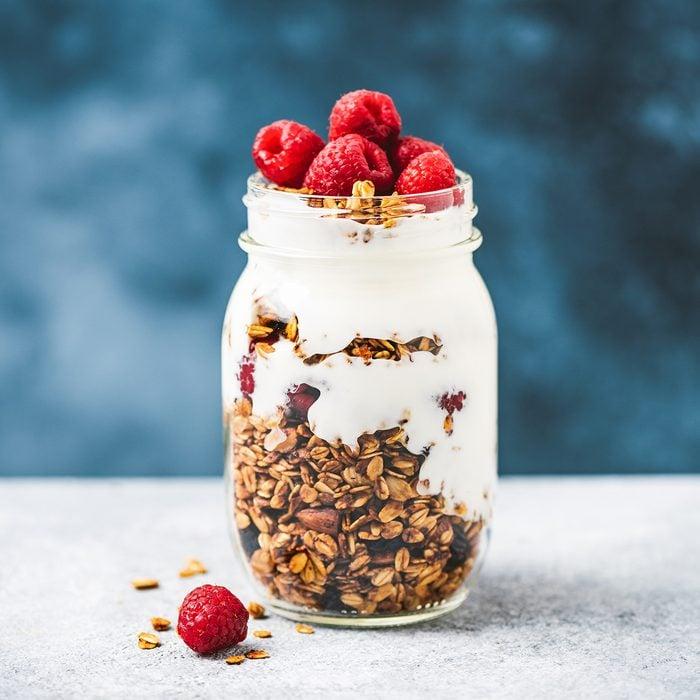 Granola with greek yogurt and raspberries in jar, healthy food, healthy eating concept