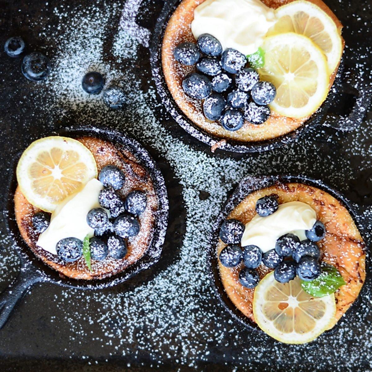 Mini Dutch Baby pancakes with fresh blueberries and Mascarpone Cream