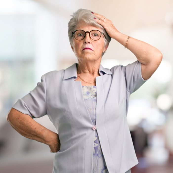 Beautiful senior woman worried and overwhelmed