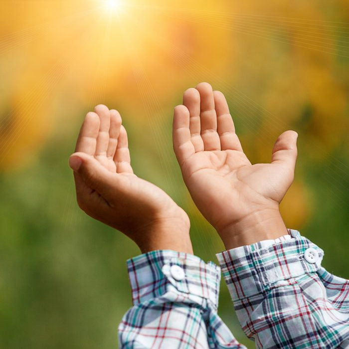 Children's open empty hands with palms up.