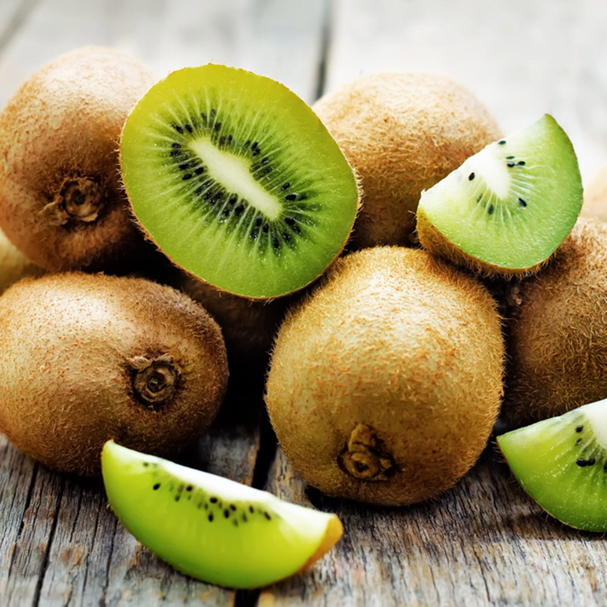 kiwi on white wood background.