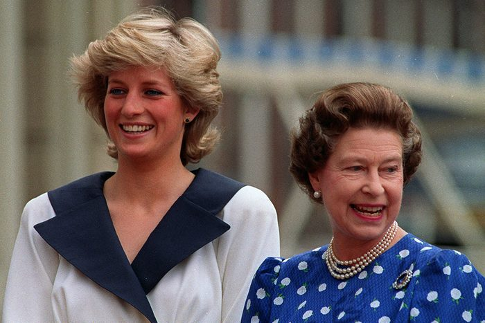 II Diana, Princess of Wales, left, and Britain's Queen Elizabeth II smile to well-wishers outside Clarence House in London