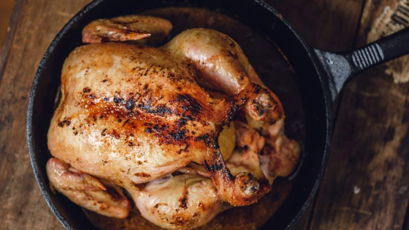 Cooked chicken in cast-iron skillet