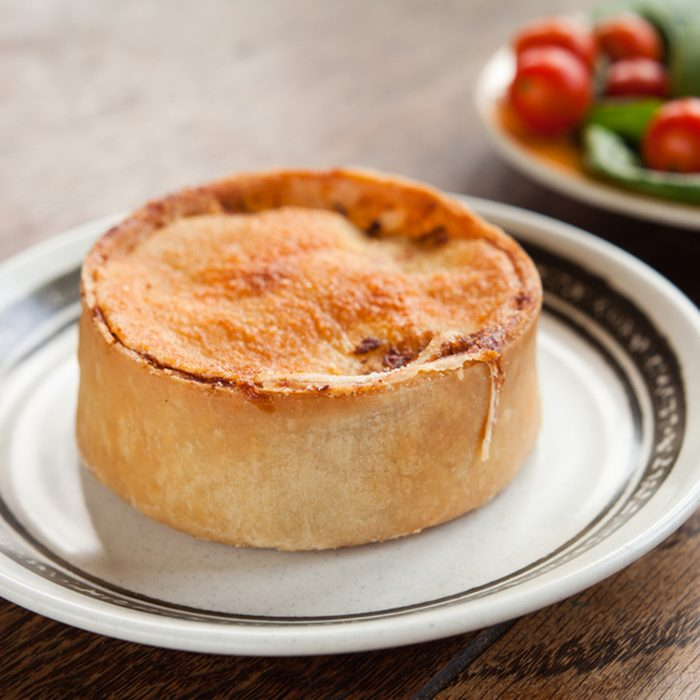 Scottish Pie - traditional stuffed fast food with different fillings. Macaroni cheese , mutton, shell, mince , football, cheese and onion, chicken and mushroom, cottage , curry, steak.