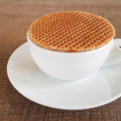 Stroopwafel a famous waffle from dutch on the black coffee cup