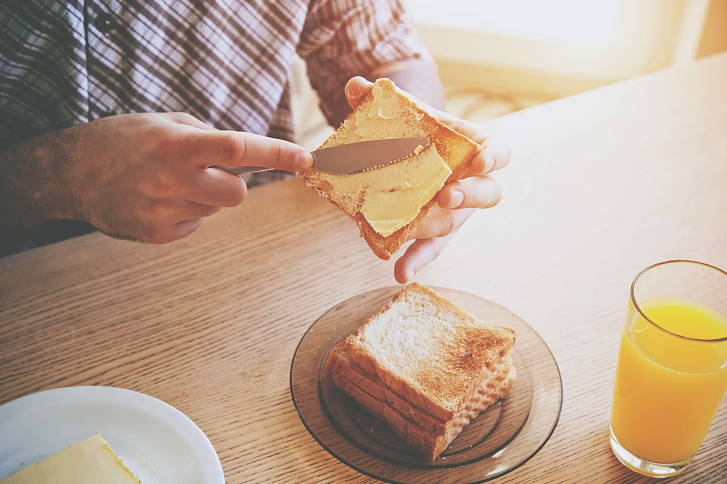 Buttering toast