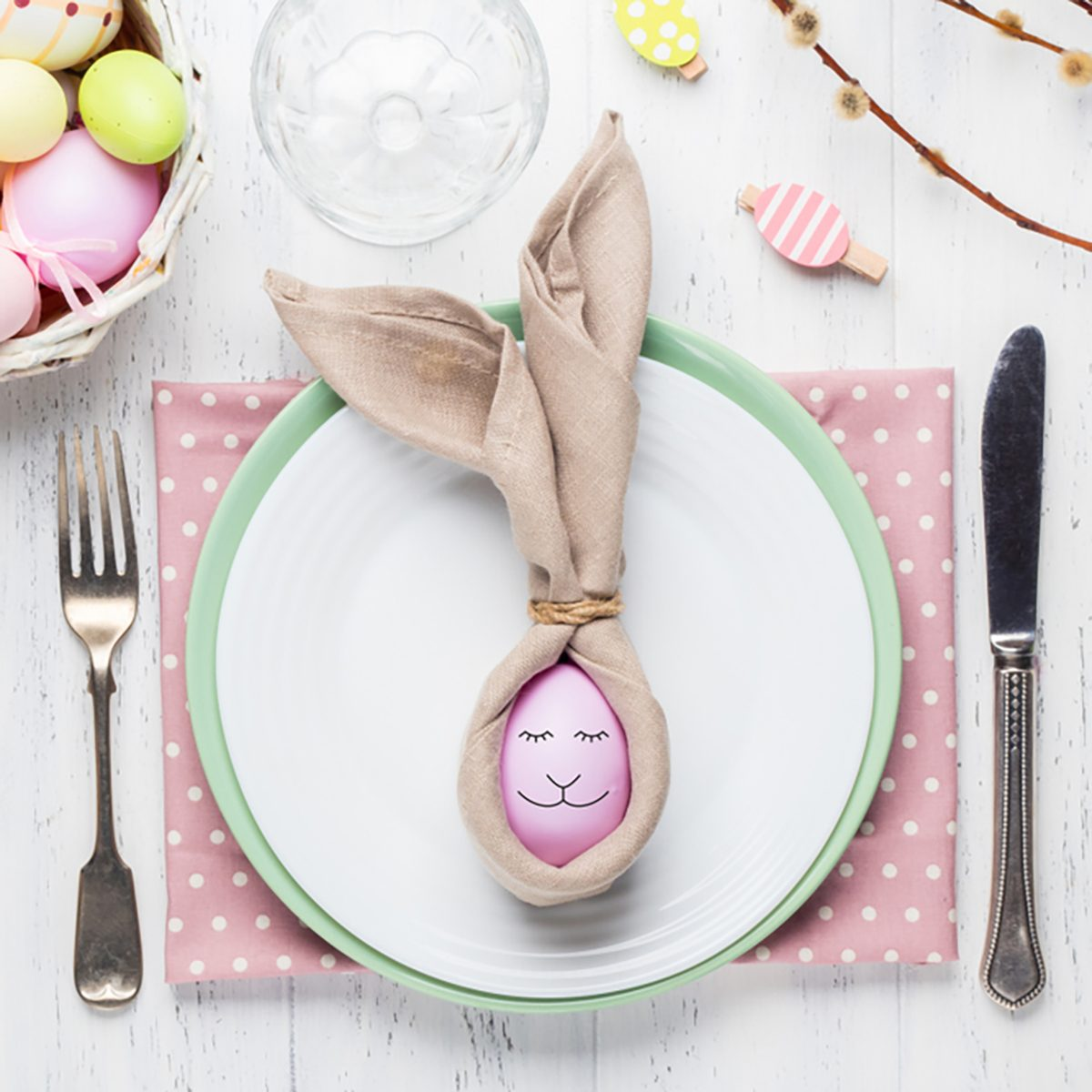 Beautiful festive Easter table setting with napkin Easter Bunny