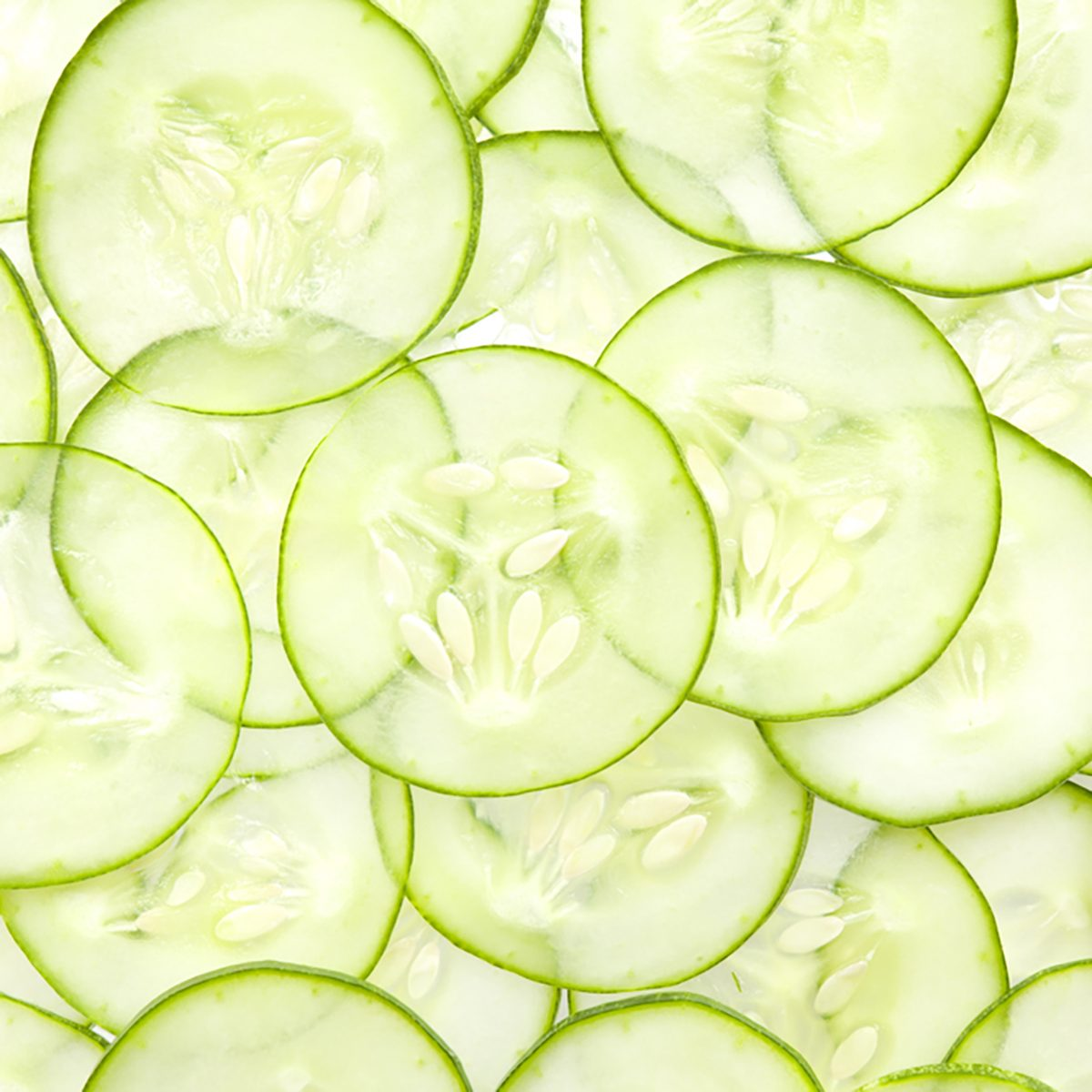 Fresh Cucumber and slices white background