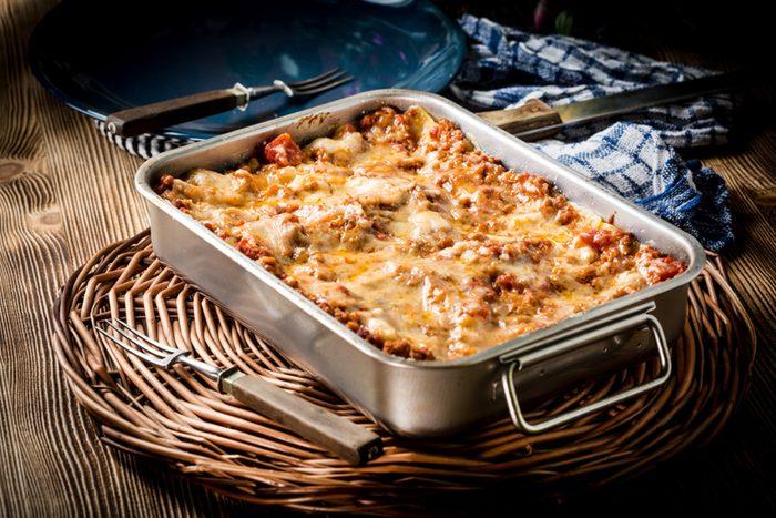 Homemade lasagne bolognese in metal baking form.
