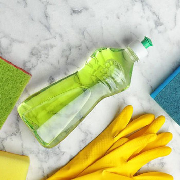 Cleaning supplies on marble countertop