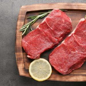 Fresh raw meat on wooden board