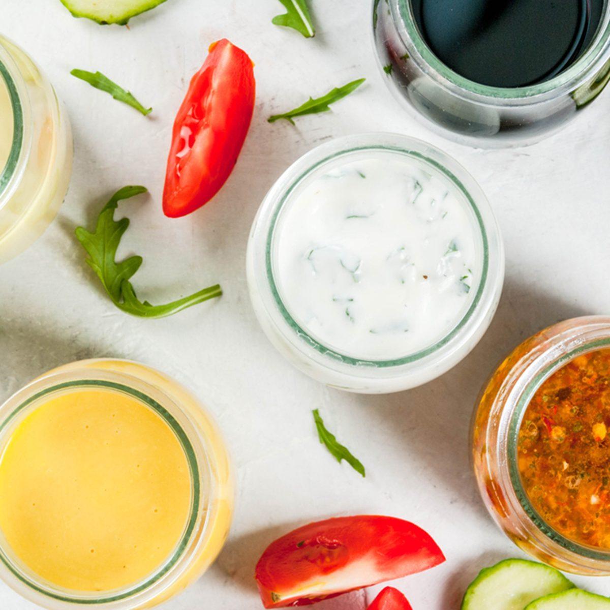 Set of dressings for salad: sauce vinaigrette, mustard, mayonnaise or ranch, balsamic or soy, basil with yogurt.
