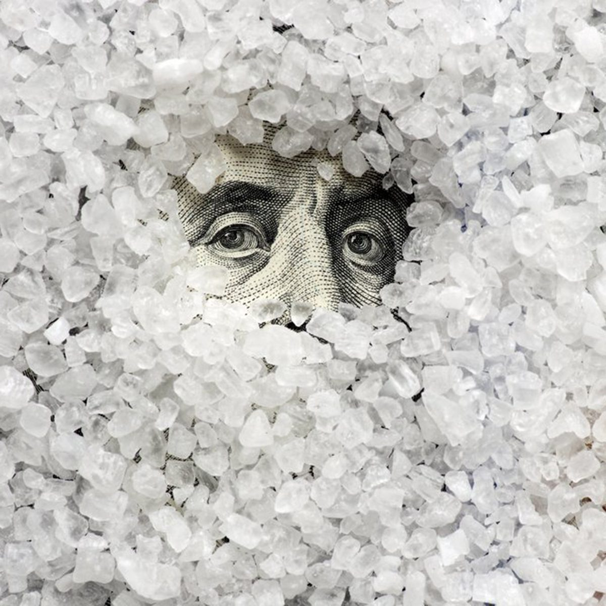 Salt covering 100 bill