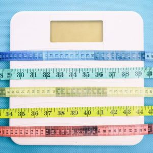 Scale wrapped in measuring tape