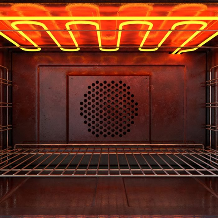 An upclose view through the front of the inside of an empty hot operational household oven with a glowing element and metal rack - 3D render; Shutterstock ID 1061325998; Job (TFH, TOH, RD, BNB, CWM, CM): TOH