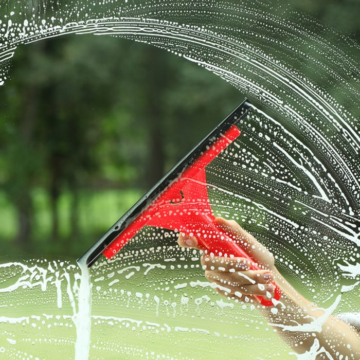 Windows cleaning, glass without smudges red squeegee; Shutterstock ID 123204070; Job (TFH, TOH, RD, BNB, CWM, CM): TOH