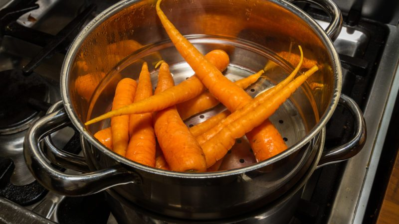 Carrots or Daucus carota in a stainless steel steamer being steamed on a hob.; Shutterstock ID 532841113; Job (TFH, TOH, RD, BNB, CWM, CM): TOH How to Steam Carrots