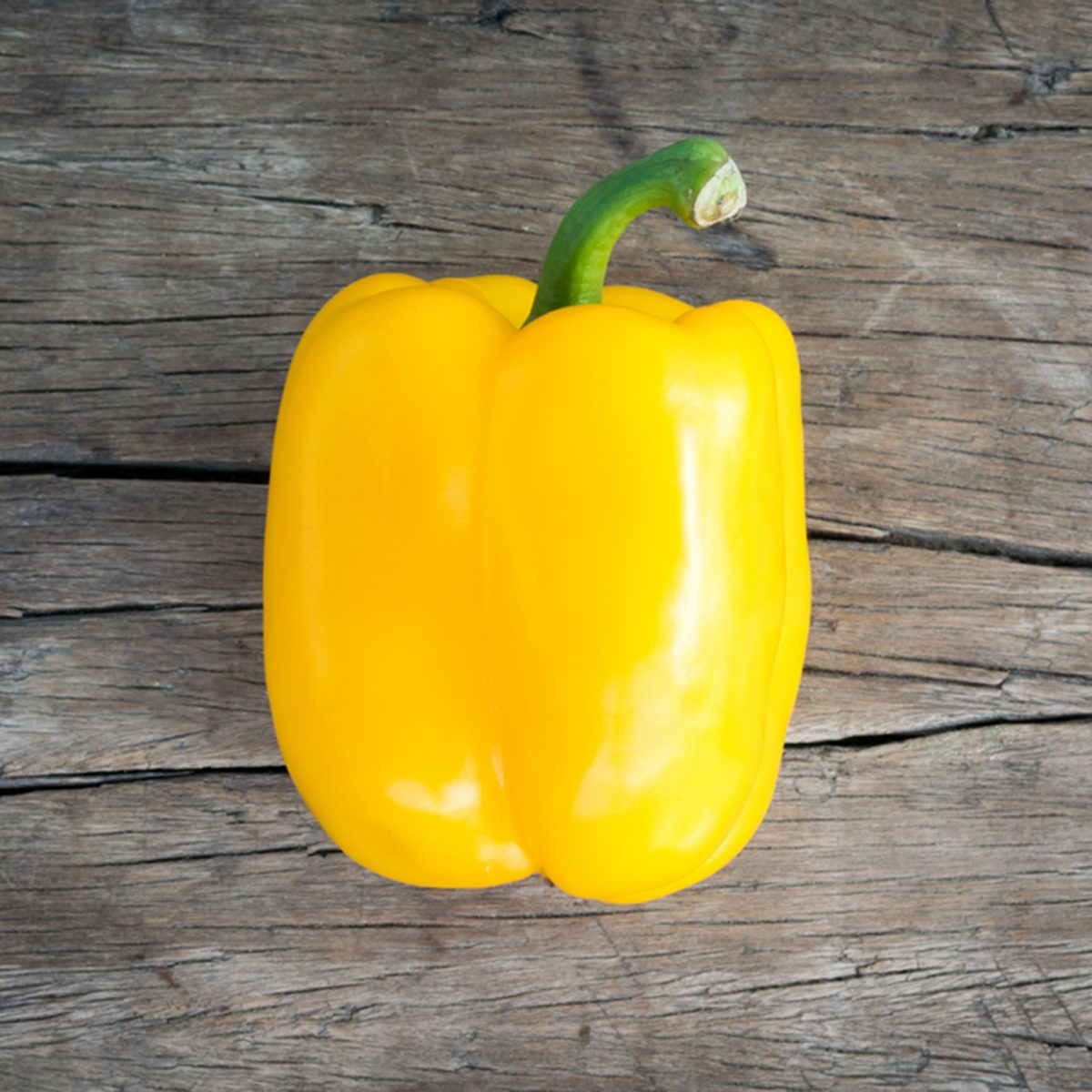 yellow Sweet bell pepper on wood background