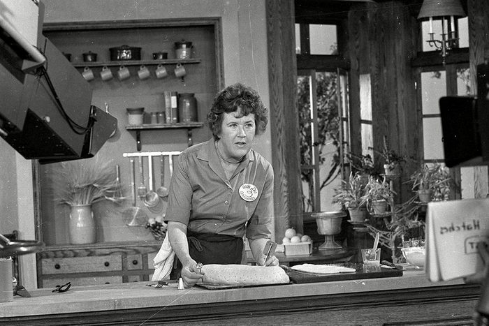CHILDS Television cooking personality Julia Child prepares a French delicacy in her cooking studio on JULIA CHILD, USA