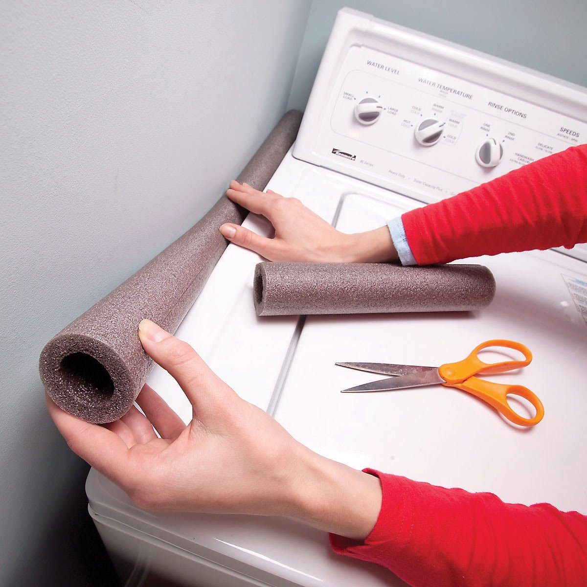Putting a pool noodle on the side of the washer