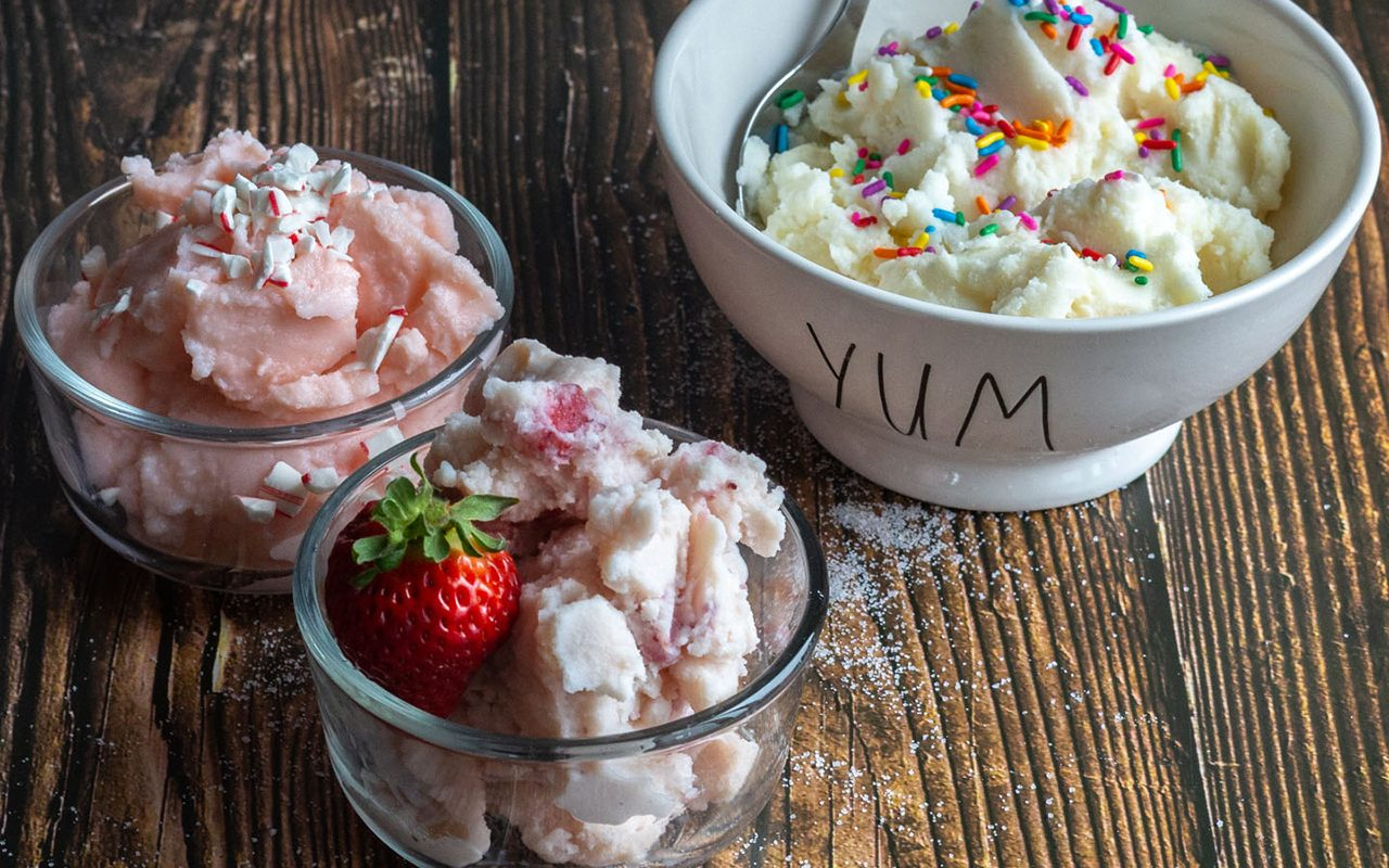 Strawberry, vanilla and peppermint ice cream in dishes.