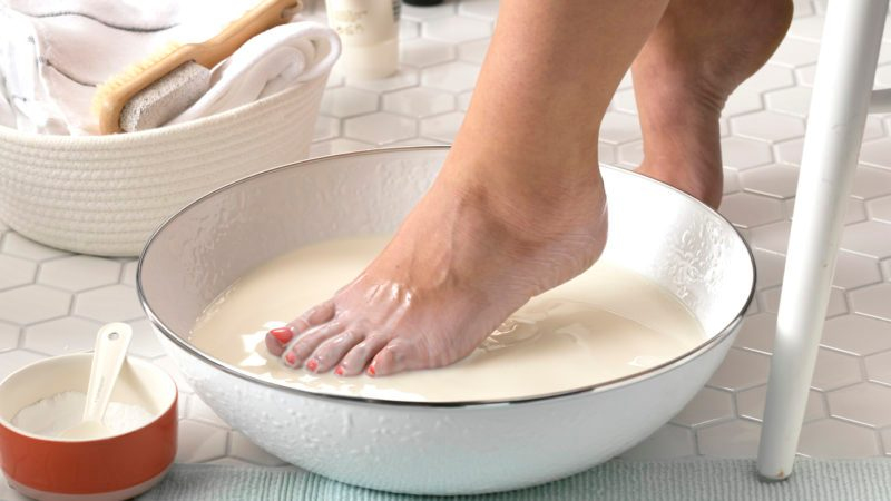 Stepping a foot into a soothing milk bath.