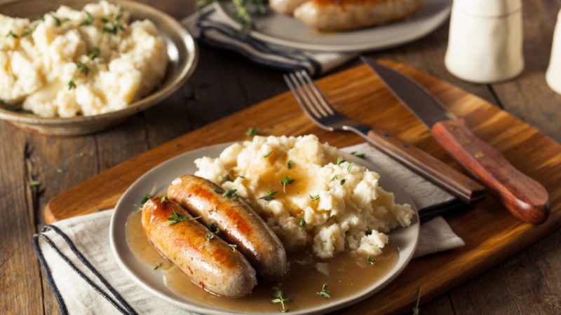 homemade irish bangers recipe served with mash and gravy