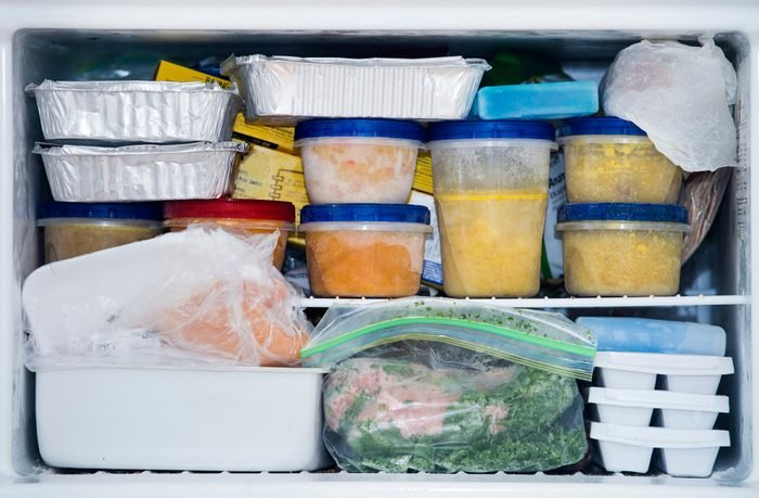 a freezer packed with chicken, soup and various frozen food; Shutterstock ID 791543500; Job (TFH, TOH, RD, BNB, CWM, CM): TOH Freezing Soup