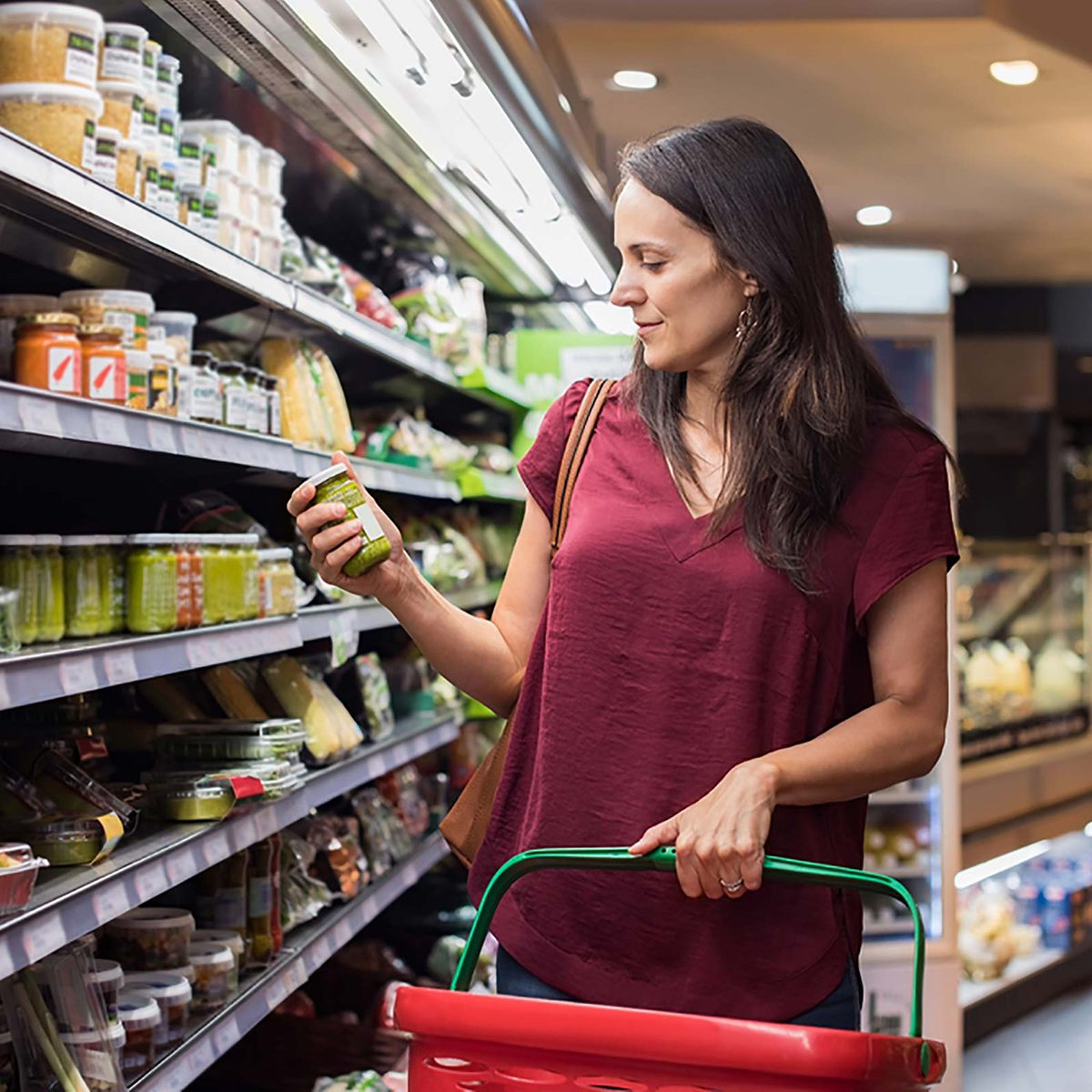Grocery shopping woman holding a jar