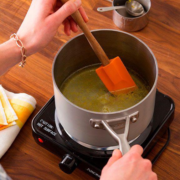 sauce pan heating up with the lemonade inside