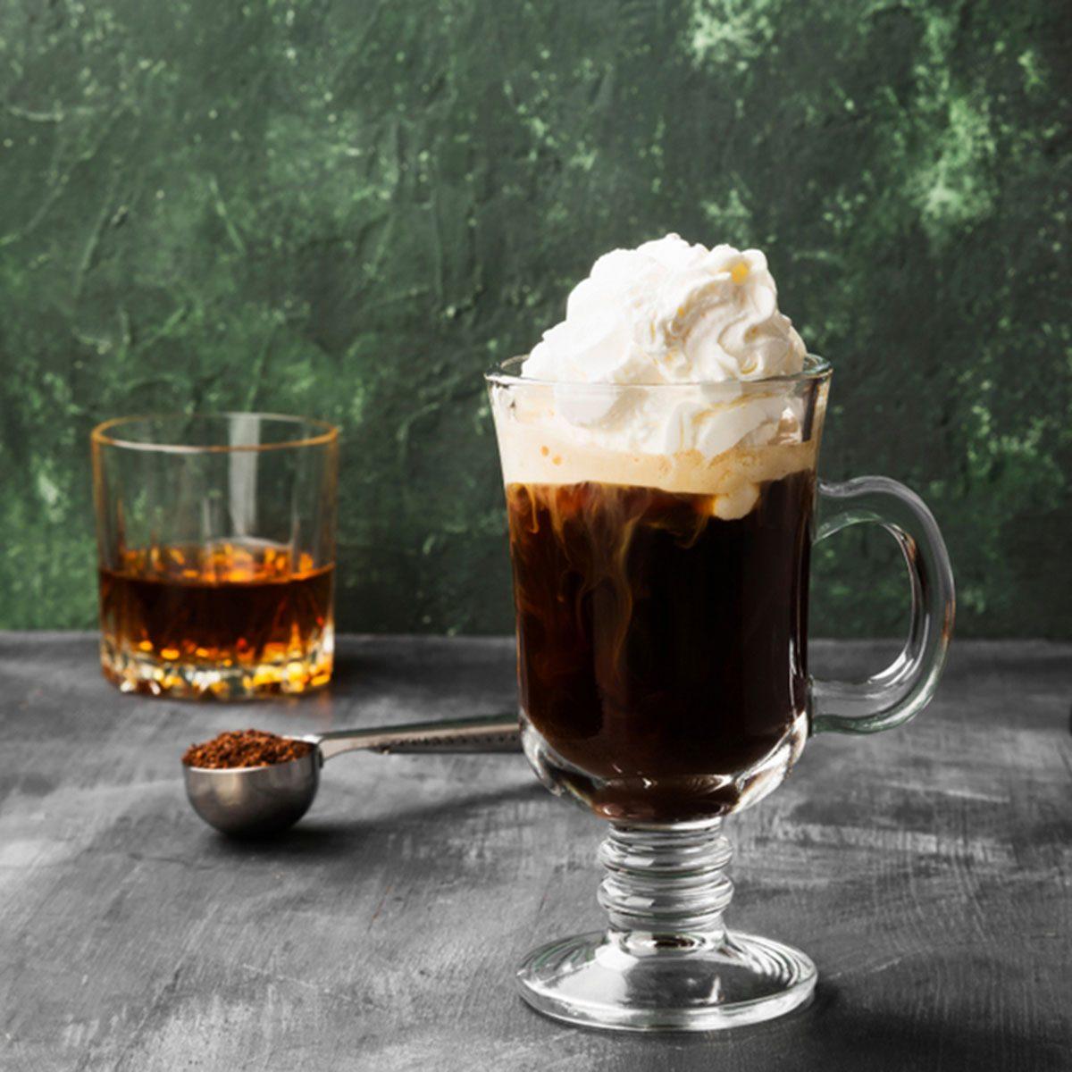 Irish coffee with whisky on dark background